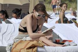 http://img165.imagevenue.com/loc223/th_312674634_Mischa_Barton_Bikini_Candids_on_the_Beach_in_Miami_December_27_2011_229_122_223lo.jpg